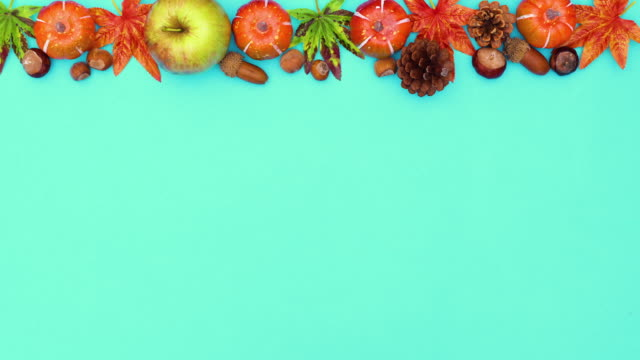 Autumn leaves and yields appear on the top of green theme. Stop motion