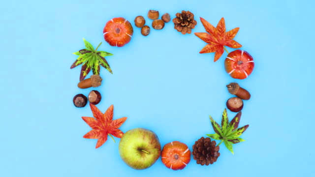 Autumn leaves and yields make round frame or text. Stop motion