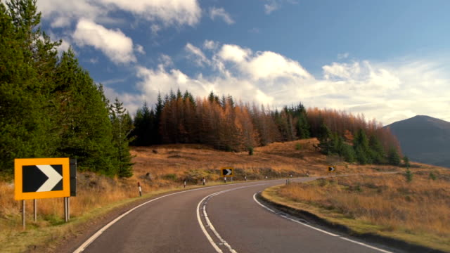 SLO MO Autumn Road, taken from forest road trip driving in highland, Scotland, UK