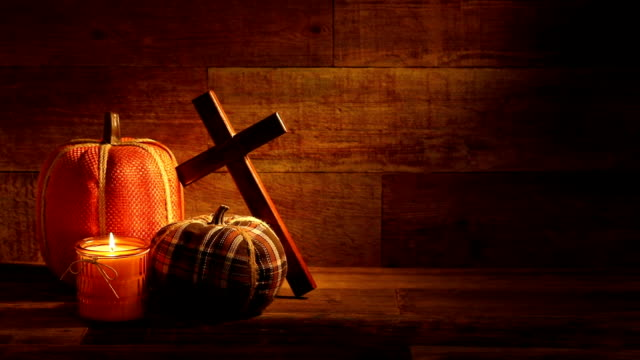 Autumn wooden background with candles and Embroidered Pumpkins video