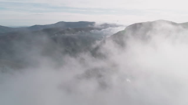 Autumn's Aerial view. Nature and Cloudscape. Mist and Fog all around creating simplicity in the Landscape. Beauty in Nature mindfulness stock videos & royalty-free footage