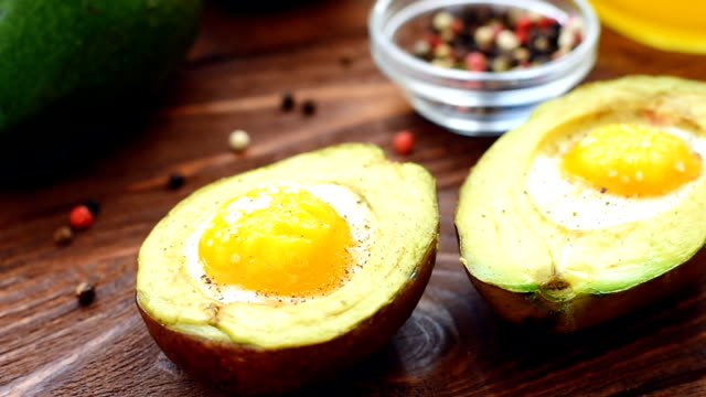 Avocado baked with egg, pepper and salt video