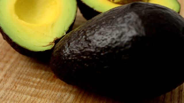Avocado on a wooden board. video