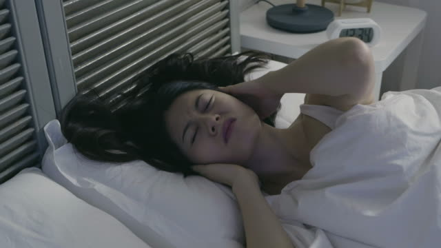 awake girl can't sleep because of insomnia. - vicino video stock e b–roll