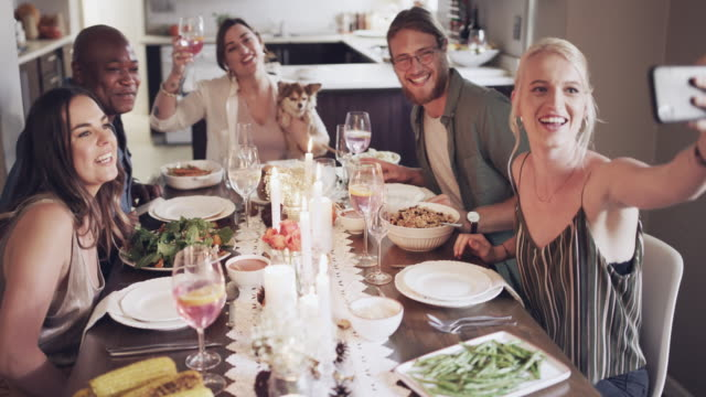 awesome feast with awesome friends - cena natale video stock e b–roll