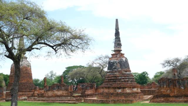 Ayutthaya temple ruins, Wat Maha That Ayutthaya as a world heritage site, Thailand. Ayutthaya historical park Ayutthaya temple ruins, Wat Maha That Ayutthaya as a world heritage site, Thailand. Ayutthaya historical park sukhothai stock videos & royalty-free footage