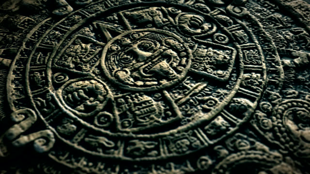 Aztec Sun Stone 30 sec seamless loop animation of spinning ancient Aztec sun stone archaeology stock videos & royalty-free footage