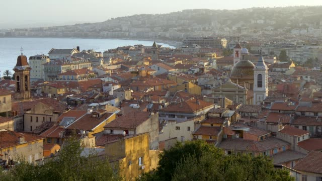 Azure coast, Nice, France. View of roofs in old city center in the sunset. Zoom out shot Azure coast, Nice, France. View of roofs in old city center in the sunset. Zoom out shot. european culture stock videos & royalty-free footage
