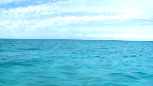 Azure tropical sea with cloudy sky from moving boat video