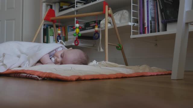 Baby Asleep on Home Floor