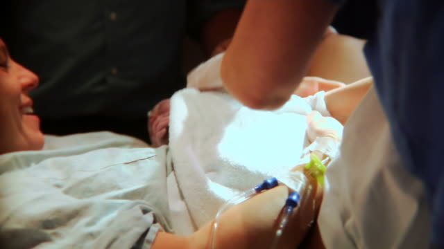 HD - Baby being born and greeted by her mother video