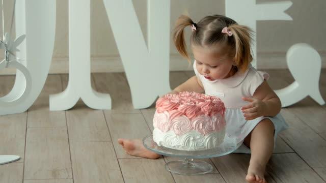 baby biting a birthday cake video
