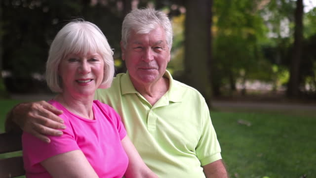Baby Boomer Couple Sit on Bench video