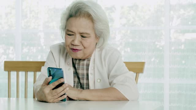 Baby boomer women while using smart phone with her friends today video
