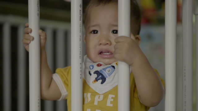 Baby boy crying in crib at home video