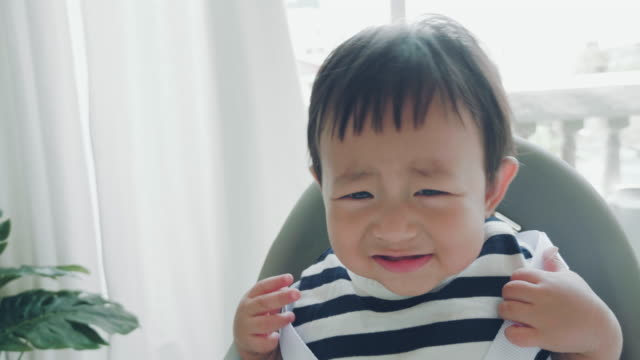 Baby Boy (6-11 months) Crying Asian Baby Boy Crying On The Chair At Home. Bangkok, Thailand. impatient stock videos & royalty-free footage