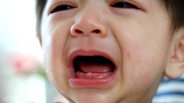baby boy crying with tears unhappy feeling video