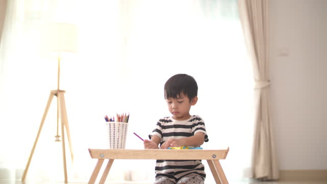 Baby boy drawing and paint follow his idea