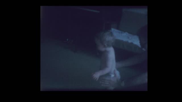 1971 baby boy in diapers crawling around - hotel reception filmów i materiałów b-roll