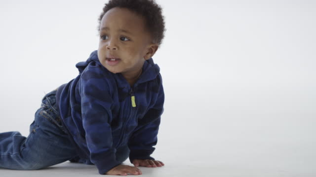 Baby boy learning to crawl video