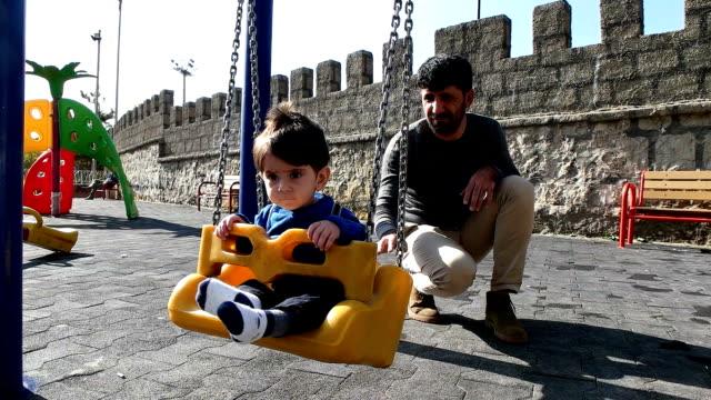 pojke på swing - mellanöstern bildbanksvideor och videomaterial från bakom kulisserna