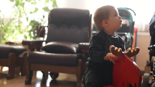 Baby Boy Riding Rocking Horse