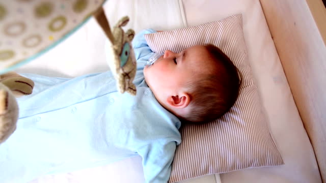 Baby boy sleeping in crib video