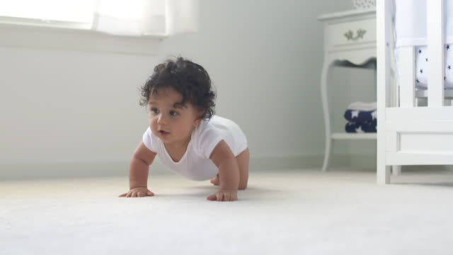 Baby Crawls Toward Rack Focus Low Angle Slow Motion video