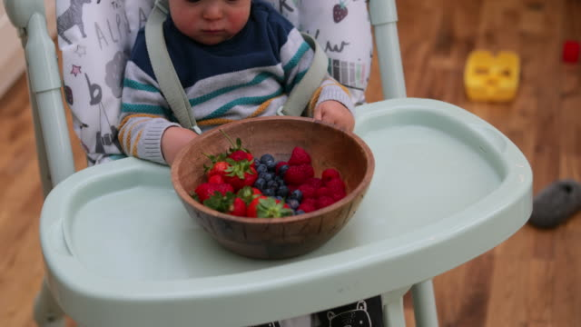 Baby Discovering New Fruit