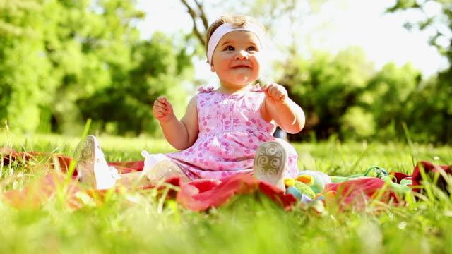 Baby enjoying in the spring sun video