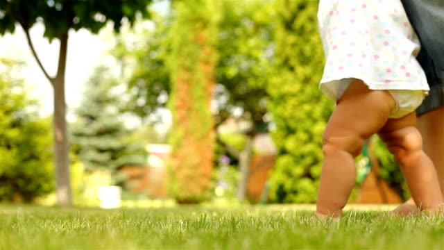 Baby first steps on grass video