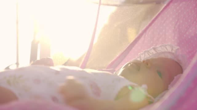 Baby girl against bright warm sunshine