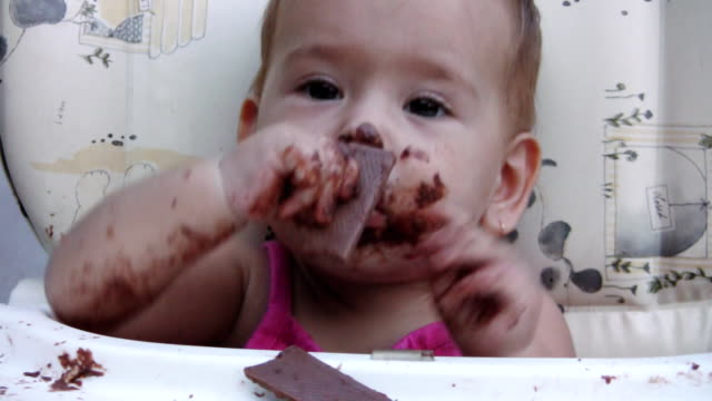 Baby girl and chocolate (HD) video
