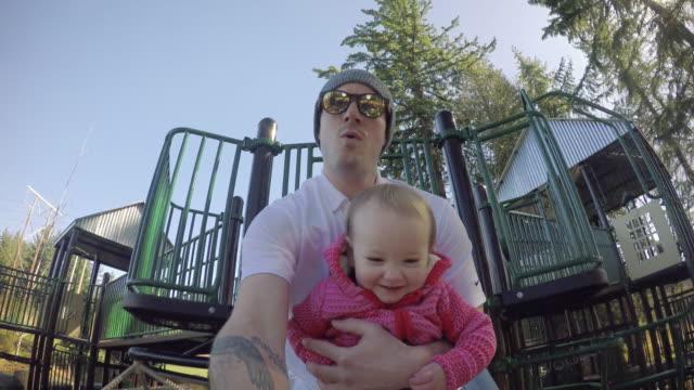 baby girl und papa park schieben selfie pov - teurer lebensstil stock-videos und b-roll-filmmaterial