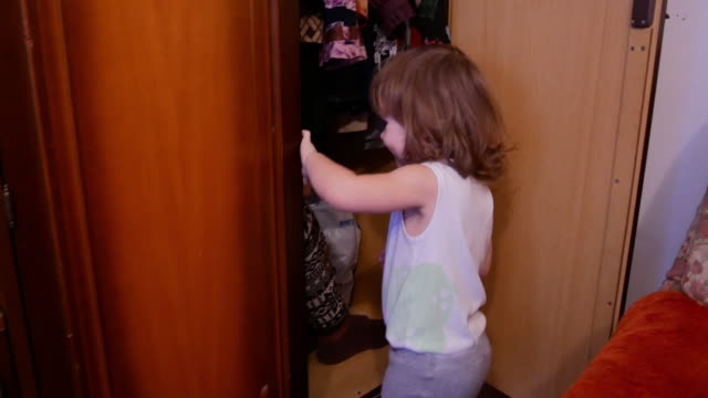 Baby girl and mom playing at home hide and seek Baby girl and mom playing at home hiding stock videos & royalty-free footage