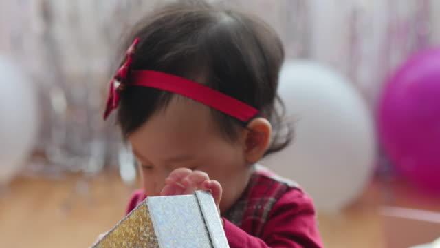 baby girl checking her gift bag video