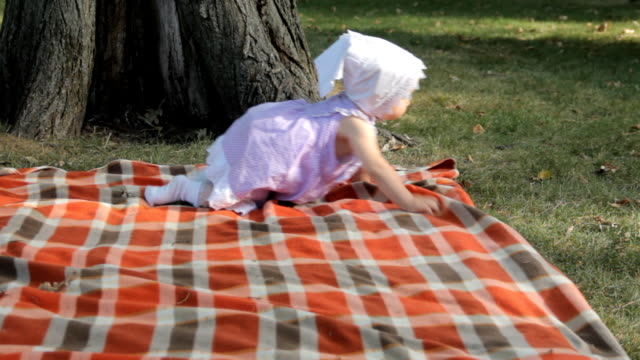 A baby girl crawling over a blanket video