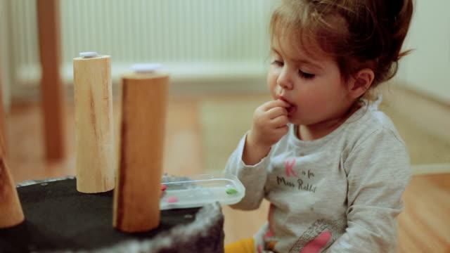 Baby girl eating colorful chocolate candy video