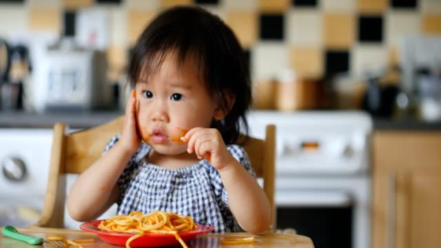 baby girl eating messy spaghetti video