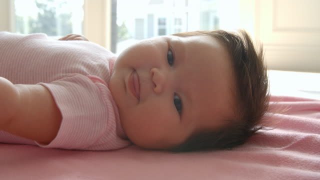 Baby Girl Laying On Pink Blanket Shot In Slow Motion video