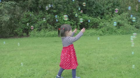 baby girl play bubbles at spring garden hand hold shoot baby girl play bubbles at spring garden childhood stock videos & royalty-free footage