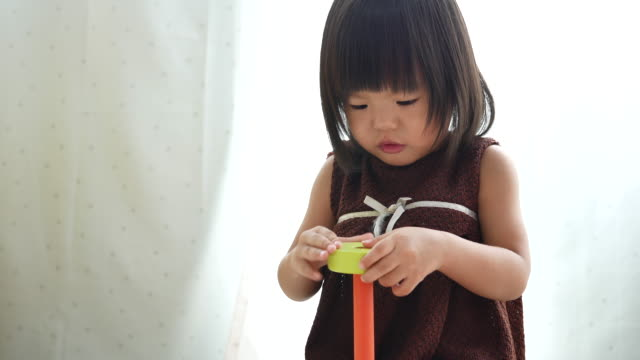 Baby girl play pretend food toy at home