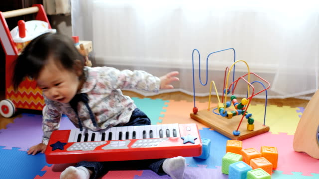 baby girl playing toy at home video