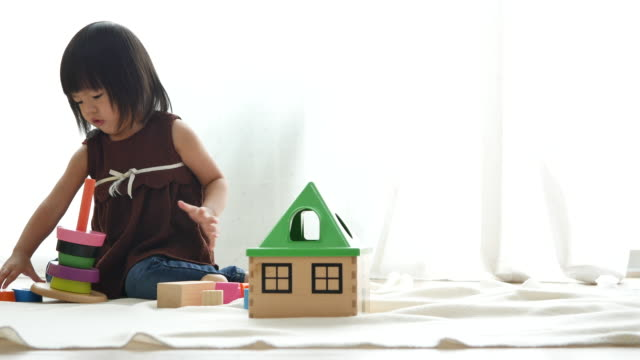Baby girl playing with blocks toy