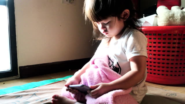 Baby girl playing with smartphone video