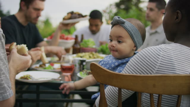 baby girl reaching for food - picnic video stock e b–roll
