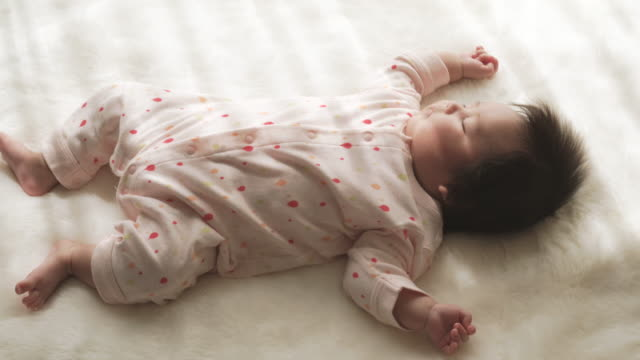 Baby girl sleeping at home. video