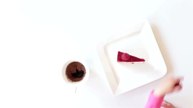 Baby girl taking raspberry from cheesecake video