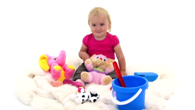 Baby Girl With Toys On White Cover video