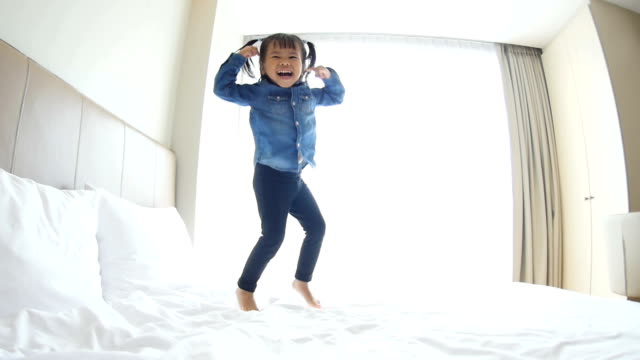 Baby Girls Jumping On The Bed video